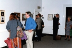 Photograph of people at exhibition opening at Huddersfield Art Gallery.